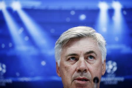 Real Madrid's coach Ancelotti gestures during a news conference on the eve of Champions League soccer match against Ludogorets at the Valdebebas training grounds, outside Madrid
