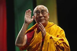 "The Dalai Lama greets the audience before his conference ""A guide to the way of life of Bodhisattva"" in Mexico City"