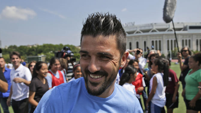 THIS CORRECTS THAT VILLA PLAYED FOR SPAIN, NOT BRAZIL - FILE -  In this July 31, 2014, file photo, David Villa, who will play for the MLS expansion New York City soccer team,  plays soccer with kids from the South Bronx United program in front of Yankee Stadium in New York. Villa is the all-time leading Spanish National Team scorer. He scored five goals as Spain won the 2010 World Cup.  (AP Photo/Seth Wenig, File)