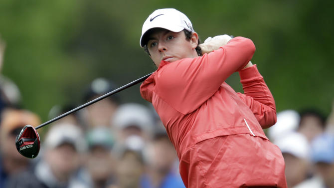 Rory McIlroy, of Northern Ireland, watches his tee shot on the fourth hole during the first round of the Wells Fargo Championship golf tournament at Quail Hollow Club in Charlotte, N.C., Thursday, May 2, 2013. (AP Photo/Bob Leverone)