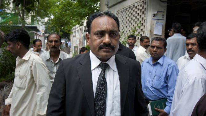 Tahir Naveed Chaudhry, the lawyer of a Christian girl accused of blasphemy, leaves after a court hearing in Islamabad, Pakistan on Tuesday, Aug 28, 2012. Chaudhry said a report by a medical board investigating the age and mental state of the girl determined she was between 13 and 14.  The girl was accused by a neighbor of burning pages from the Quran.   (AP Photo/Anjum Naveed)
