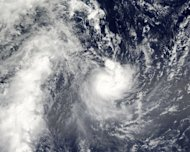 "Tropical Cyclone Evan is photographed by NASA's Aqua satellite on December 13, 2012 as it passes over Samoa. Authorities scrambled to evacuate tourists and residents in low-lying areas Sunday as a monster cyclone threatened Fiji with ""catastrophic damage"""