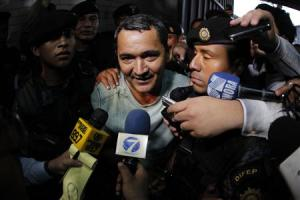 Waldemar Lorenzana speaks with members of the media after his arrest at the Supreme Court of Justice in Guatemala City