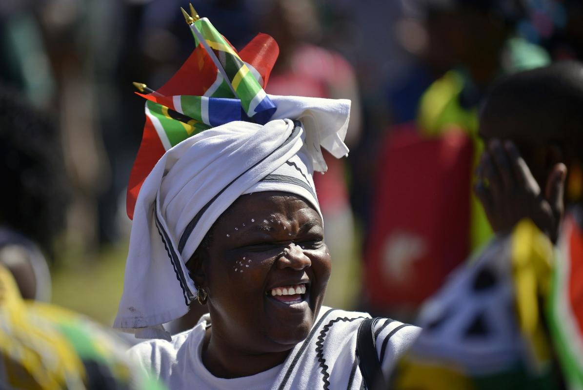 A woman cheers during Freedom Day celebrations at the Union Buildings in Pretoria