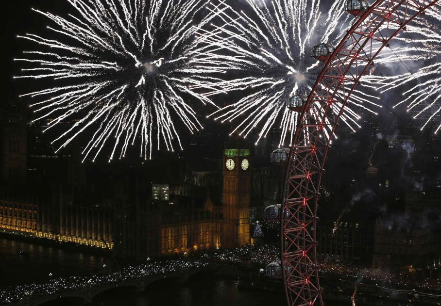 Fireworks explode across the London skyline near the London Eye during New Year celebrations in London