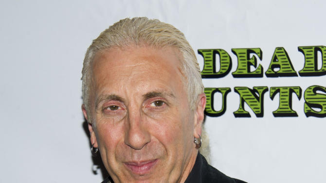 """FILE - In this Nov. 12, 2012 file photo, Dee Snider arrives at the opening night performance of the Broadway play """"Dead Accounts,"""" in New York. Snider, lead singer of the '80s heavy metal band Twisted Sister, will be headlining the nightclub 54 Below, taking on such standards as """"Mack the Knife"""" and """"Cabaret."""" (Photo by Charles Sykes/Invision/AP, File)"""
