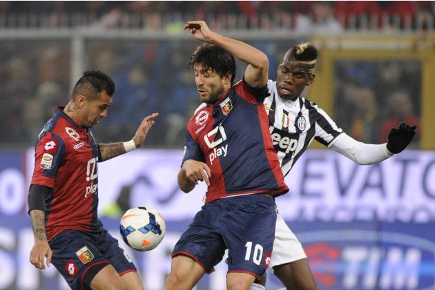 Juventus' Pogba challenges Genoa's Matuzalem and Giuseppe Sculli during their Italian Serie A soccer match at Luigi Ferraris stadium in Genoa