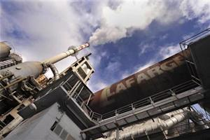 Smoke rises from a furnace at Lafarge cement factory in Trbovlje