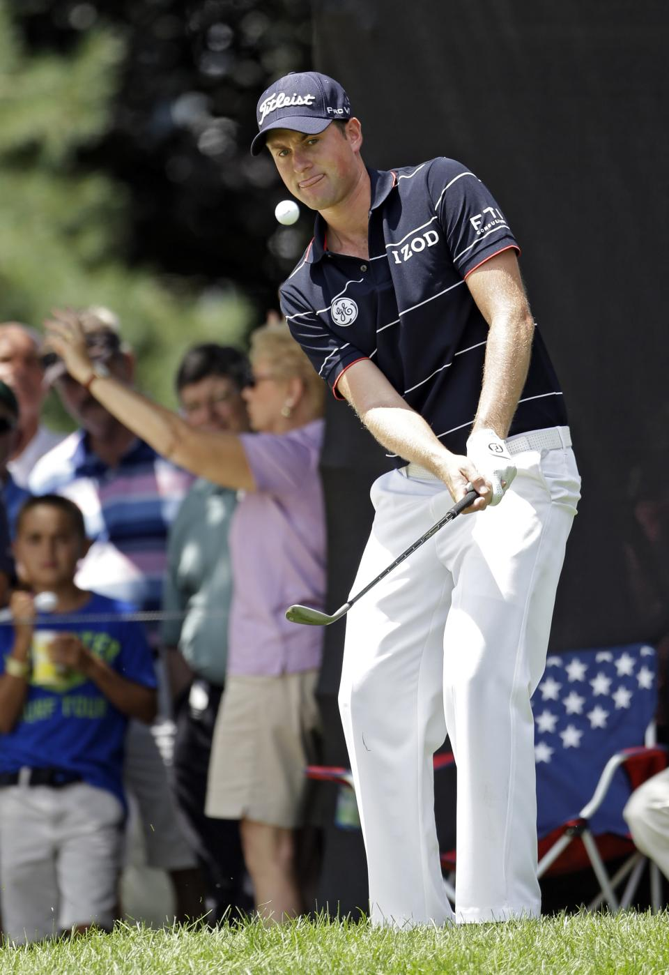 Webb Simpson chips to the ninth green during the first round of the Bridgestone Invitational golf tournament Thursday, Aug. 1, 2013 at Firestone Country Club in Akron, Ohio. Simpson finished his round at 6-under par. (AP Photo/Mark Duncan)