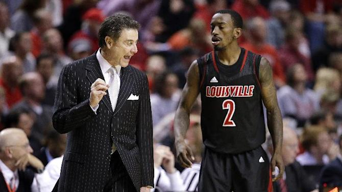 FILE - In this Dec. 22, 2012, file photo, Louisville head coach Rick Pitino talks with guard Russ Smith (2) in the second half of an NCAA college basketball game against Western Kentucky  in Nashville, Tenn. The Cardinals have shown that they are comfortable being front-runners in their season-long quest to go farther than last year's Final Four appearance. Now, they enter the NCAA tournament as the overall No 1 seed. (AP Photo/Mark Humphrey, File)