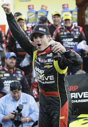 Jeff Gordon celebrates winning the NASCAR Sprint Cup auto race at Martinsville Speedway in Martinsville, Va., Sunday, Oct. 27, 2013. (AP Photo/Steve Helber)