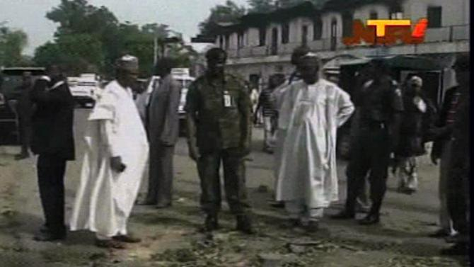 In this frame grab from TV footage shot by the Nigeria television authority on Monday, Oct. 8, 2012 but aired Tuesday, Oct. 9, 2012, government officials are seen at the site of an bomb explosion in Maiduguri, Nigeria, which was carried out Monday by suspected members  the extremist Islamist sect, Boko Haram, which holds this city in the grip of bloody violence.   (AP Photo / Nigeria Television Authority)