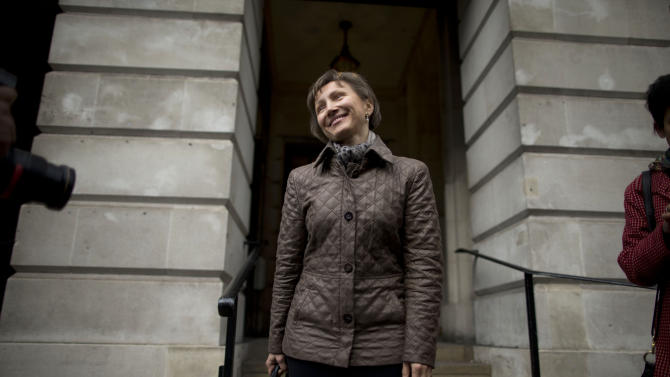 Marina Litvinenko, the widow of former Russian intelligence officer Alexander Litvinenko, poses for photographers after attending a pre-Inquest review at Camden Town Hall in London, Friday, Nov. 2, 2012. A British lawyer says previously unreleased details of the British investigation into the murder of ex-Russian agent Alexander Litvinenko may be made public during an inquest into his death. Litvinenko died in 2006 after ingesting polonium, a rare radioactive poison. The former Russian FSB agent blamed the Kremlin for his death, and the killing took relations between Moscow and London to a post-Cold War low. (AP Photo/Matt Dunham)