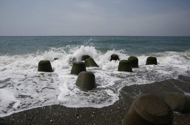 Waves crash on tetrapods at a beach near Chubu Electric Power Co.'s Hamaoka Nuclear Power Station in Omaezaki
