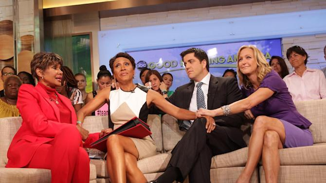 """This image released by ABC shows """"Good Morning America"""" co-host Robin Roberts, second left, with her sister Sally-Ann Roberts, left, and co-hosts Josh Elliott and Lara Spencer, right, on the popular morning show on Thursday, Aug. 30, 2012 in New York. Roberts has said goodbye to """"Good Morning America,"""" but only for a while. The """"GMA"""" anchor made her final appearance Thursday before going on medical leave for a bone marrow transplant. Roberts' departure was first planned for Friday, but she chose to exit a day early to visit her ailing mother in Mississippi. In July she first disclosed that she has MDS, a blood and bone marrow disease. She will be hospitalized next week to prepare for the transplant. The donor will be her older sister, Sally-Ann Roberts. (AP Photo/ABC, Fred Lee)"""