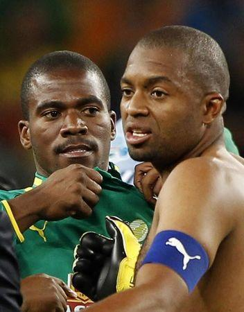 File picture of South African goalkeepers Meyiwa and Khune look on at the end of their international friendly soccer match against Spain in Johannesburg