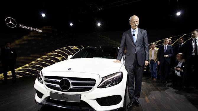 Chairman of Daimler AG and Head of Mercedes-Benz Cars Dieter Zetsche stands next to the new Mercedes-Benz 2015 C-Class during a private preview for media at the Westin Book Cadillac Hotel in Detroit