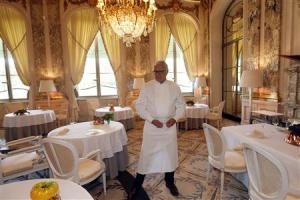 French chef Alain Ducasse poses in the dining room at Le Meurice Restaurant in Paris