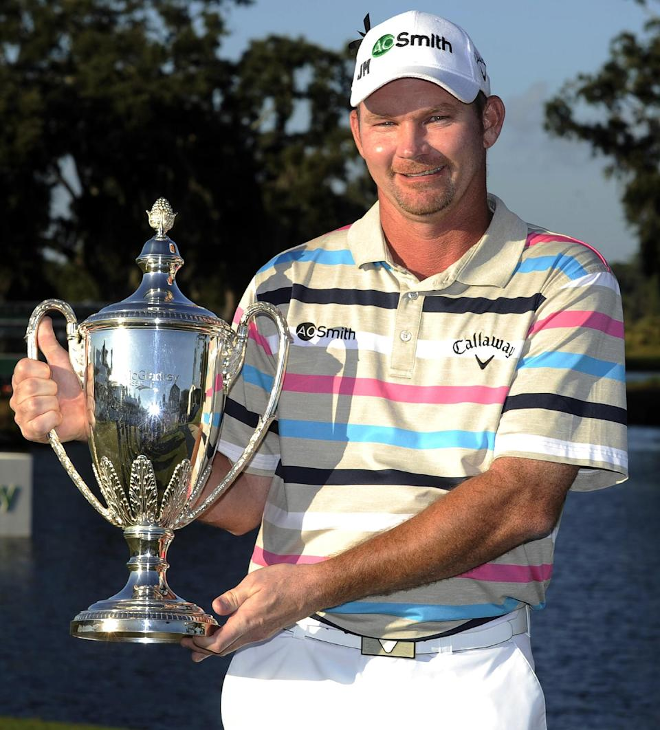 Tommy Gainey holds the trophy after winning the McGladrey Classic PGA Tour golf tournament, Sunday, Oct. 21, 2012, in St. Simons Island, Ga. (AP Photo/Stephen Morton)