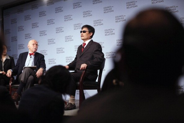 Chinese activist Chen Guancheng (R) speaks as Jerome Cohen (L), adjunct senior fellow for Asia studies at the Council on Foreign Relations, looks on at the Council on Foreign Relations on May 31, 2012