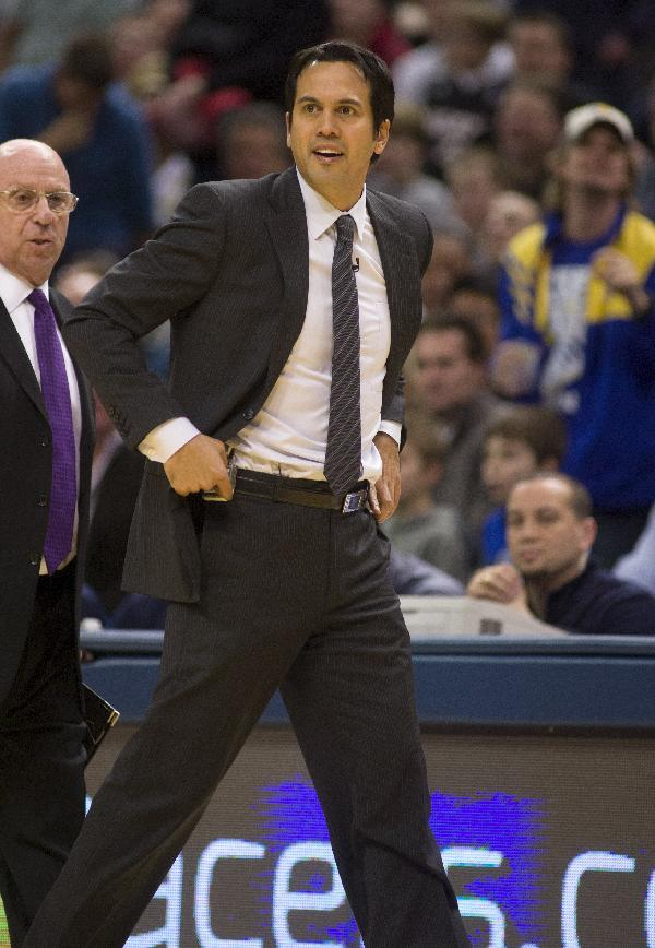 Miami Heat head coach Erik Spoelstra paces in front of the team bench after being called for a technical foul during the second half of an NBA basketball game against the Indiana Pacers in Indianapolis, Friday, Feb. 1, 2013. The Pacers defeated the Heat 102-89. (AP Photo/Doug McSchooler)
