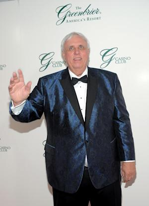 FILE - In this July 2, 2010 file photo released by The Greenbrier Resort, The Greenbrier Resort owner and chairman Jim Justice attends the gala opening of The Greenbrier Casino Club, in White Sulphur Springs, W.Va. Worth an estimated $1.7 billion, Justice is a prominent member of the tiny West Virginia community of Lewisburg, keeping a modest home and finding time to coach basketball at the local high school. But his coal operations in Appalachia are struggling as business owners have filed at least nine lawsuits since late 2011 claiming they are not being paid for work at Justice mines. (AP Photo/Evan Agostini for The Greenbrier Resort, File)