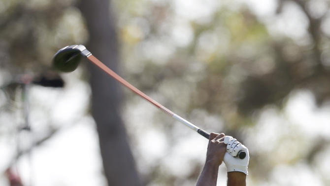USA's Tiger Woods hits a drive on the seventh hole during a four-ball match at the Ryder Cup PGA golf tournament Saturday, Sept. 29, 2012, at the Medinah Country Club in Medinah, Ill. (AP Photo/David J. Phillip)