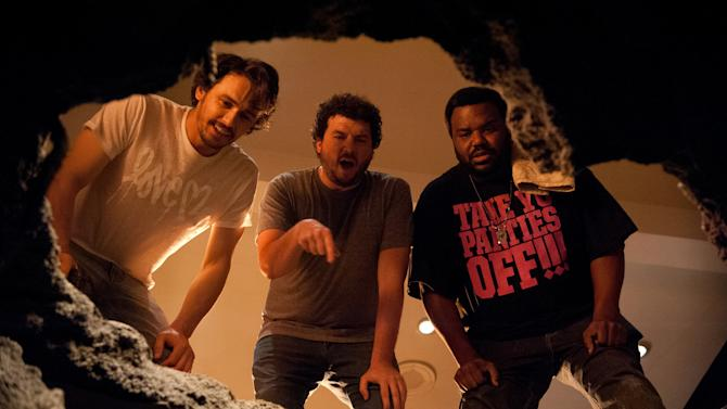 """This film publicity image released by Columbia Pictures shows, from left, James Franco, Danny McBride and Craig Robinson in a scene from """"This Is The End."""" (AP Photo/Columbia Pictures - Sony, Suzanne Hanover)"""