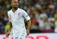 English defender Ashley Cole reacts after missing his shot during the penalty shoot out of the Euro 2012 football championships quarter-final match England vs Italy at the Olympic Stadium in Kiev. England's penalty curse struck again here Sunday as Italy advanced to the semi-finals of Euro 2012 with victory in a shoot-out after a tense quarter-final duel finished 0-0 following extra-time