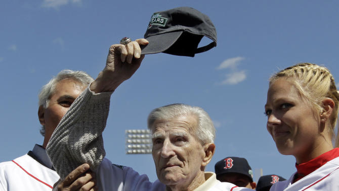 FILE - In this April 13, 2012, file photo, Boston Red Sox great Johnny Pesky tips his cap to the fans prior to Boston's home opener baseball game against the Tampa Bay Rays at Fenway Park in Boston. Pesky, who spent most of his 60-plus years in pro baseball with the Red Sox and was beloved by the team's fans, has died on Monday, Aug. 13, in Danvers, Mass. He was 92. (AP Photo/Elise Amendola, File)