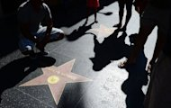 A woman and child holding hands approach the Marilyn Monroe Star along Hollywood's Walk of Fame on Hollywood Boulevard on July 28. The buxom beauty died 50 years ago, from an overdose of sleeping pills, at just 36 years old