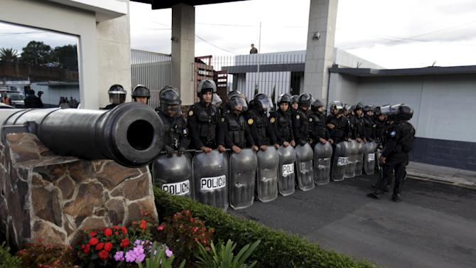 Police officers wait for Perez's arrival at Matamoros Army Base