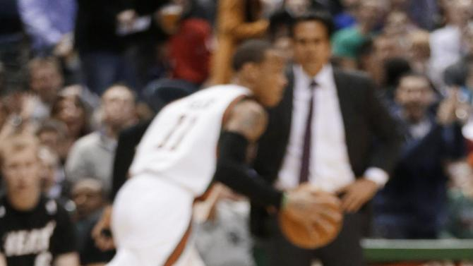 Miami Heat's Dwyane Wade reacts after hitting the floor during the first half of an NBA basketball game against the Milwaukee Bucks on Friday, March, 15 2013, in Milwaukee. (AP Photo/Jeffrey Phelps)