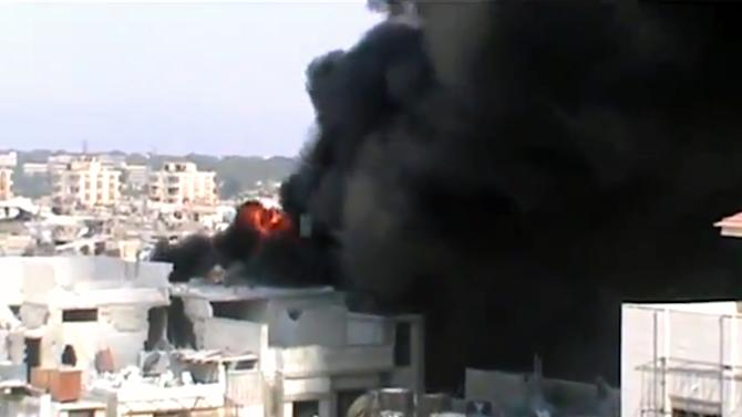This image made from amateur video released by Shaam News Network and accessed by the Associated Press Saturday, July 21, 2012 purports to show the spread of fires as a result of the shelling of Homs, Syria by government forces on July 21, 2012. (AP Photo/Shaam News Network via AP video) IMAGE MADE FROM AMATEUR VIDEO RELEASED BY SHAAM NEWS NETWORK AND ACCESSED VIA AP VIDEO SATURDAY, JULY 21, 2012. THE ASSOCIATED PRESS CANNOT INDEPENDENTLY VERIFY THE CONTENT, DATE, LOCATION OR AUTHENTICITY OF THIS MATERIAL.