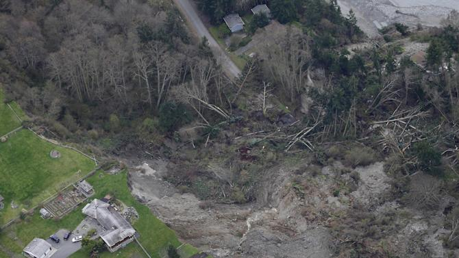 A house sits near the edge of a landslide, near Coupeville, Wash. on Whidbey Island, Wednesday, March 27, 2013. The slide severely damaged one home and isolated or threatened more than 30 on the island, about 50 miles north of Seattle in Puget Sound. No one was reported injured in the slide, which happened at about 4 a.m. Wednesday. (AP Photo/Ted S. Warren)