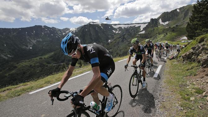New overall leader Christopher Froome of Britain, left, climbs Pailheres pass followed by Spain's Alejandro Valverde during the eight stage of the Tour de France cycling race over 195 kilometers (122 miles) with start in Castres and finish in Ax 3 Domaines, Pyrenees region, France, Saturday July 6 2013. (AP Photo/Christophe Ena)