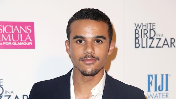 """Jacob Artist arrives at the premiere of """"White Bird in a Blizzard"""" presented by FIJI Water on Tuesday, Oct. 21, 2014 in Los Angeles. (Photo by Matt Sayles/Invision for FIJI Water/AP Images)"""
