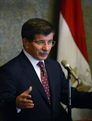 Turkish Foreign Minister Ahmet Davutoglu, pictured in September 2012, called UN chief Ban Ki-moon, NATO chief Anders Fogh Rasmussen and the UN's Syria peace envoy Lakhdar Brahimi over shelling from Syria which killed five people in Turkey, his office said