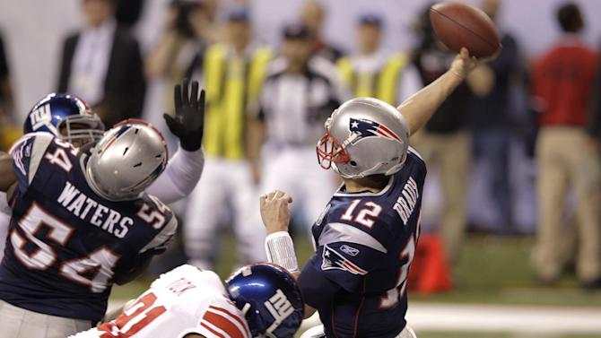 New York Giants defensive end Justin Tuck sacks New England Patriots quarterback Tom Brady for a safety during the first half of NFL Super Bowl XLVI football game, Sunday, Feb. 5, 2012, in Indianapolis. (AP Photo/Michael Conroy)