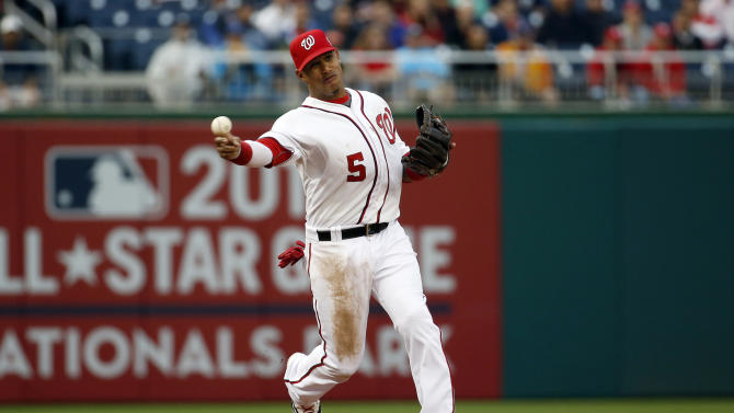 Washington Nationals third baseman Yunel Escobar throws to first base, but Toronto Blue Jays' Russell Martin arrived safely during the first inning of the second baseball game of a doubleheader at Nationals Park, Tuesday, June 2, 2015, in Washington. (AP Photo/Alex Brandon)