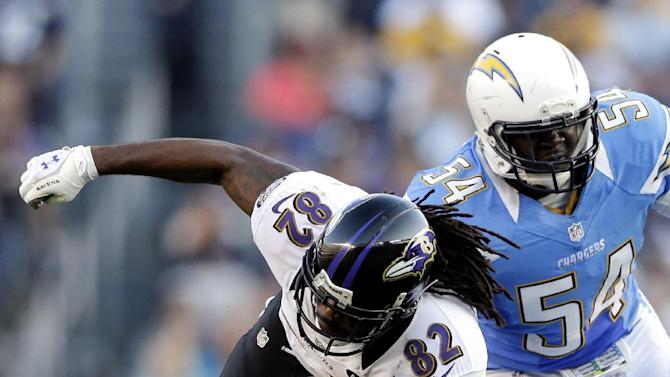 Baltimore Ravens wide receiver Torrey Smith (82) is tackled by San Diego Chargers defensive back Corey Lynch (41) as Melvin Ingram looks on during the second half of an NFL football game, Sunday, Nov. 25, 2012, in San Diego. (AP Photo/Gregory Bull)
