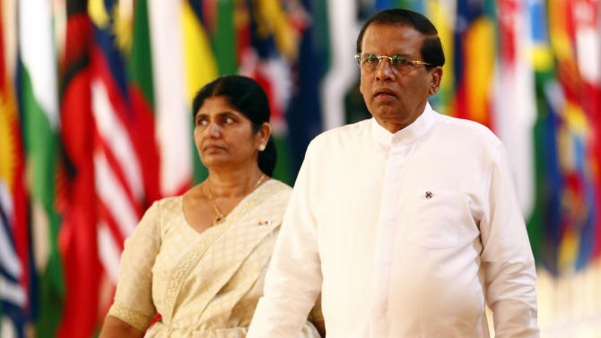 Sri Lanka's President Sirisena and his wife Jayanthi arrive for the opening ceremony of the Commonwealth Heads of Government Meeting in Valletta