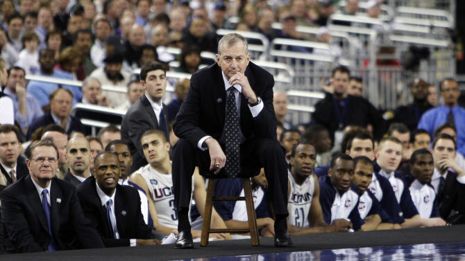 FILE - In this April 4, 2009, file photo, Connecticut head coach Jim Calhoun, center, watches from the sideline during a men's NCAA Final Four semifinal college basketball game against Michigan State in Detroit. Calhoun is expected to announce his retirement on Thursday, Sept. 13, 2012, according to a person familiar with the situation. (AP Photo/Paul Sancya, File)