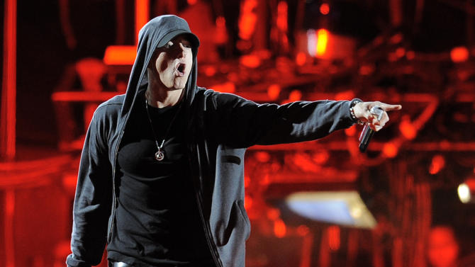 """FILE - In this April 15, 2012 file photo Eminem performs at the 2012 Coachella Valley Music and Arts Festival in Indio, Calif. The music publishers for American rapper Eminem are suing New Zealand's ruling political party over the music it used in a campaign commercial. Eight Mile Style and Martin Affiliated both claim the National Party breached copyright laws by using Eminem's song """"Lose Yourself."""" A spokesman for the two companies, Joel Martin, said they filed a case Tuesday, Sept. 16, 2014, in the New Zealand High Court and are seeking damages.(AP Photo/Chris Pizzello, File)"""