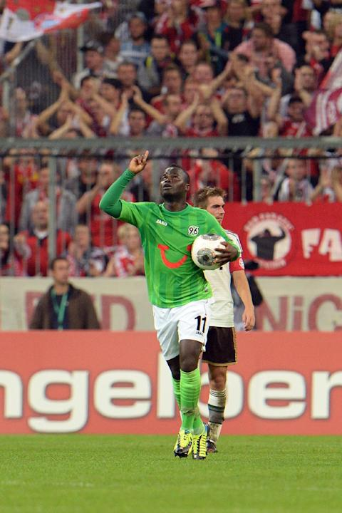 Hannover's Didier Ya Konan of Ivory Coast celebrates after scoring during the German soccer cup second round match between FC Bayern Munich and Hannover 96, in Munich, southern Germany, Wednesday, Sep