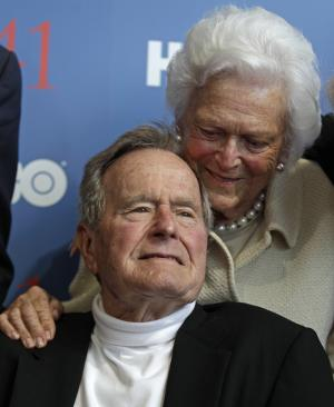 "Former President George H.W. Bush, and his wife Barbara, arrive for the premiere of HBO's new documentary on his life in Kennebunkport, Maine, Tuesday, June 12, 2012.  The premiere of ""41"" was held Tuesday on Bush's 88th birthday on the grounds of St. Ann's Church in Kennebunkport, near the Bush family's summer home.(AP Photo/Charles Krupa)"