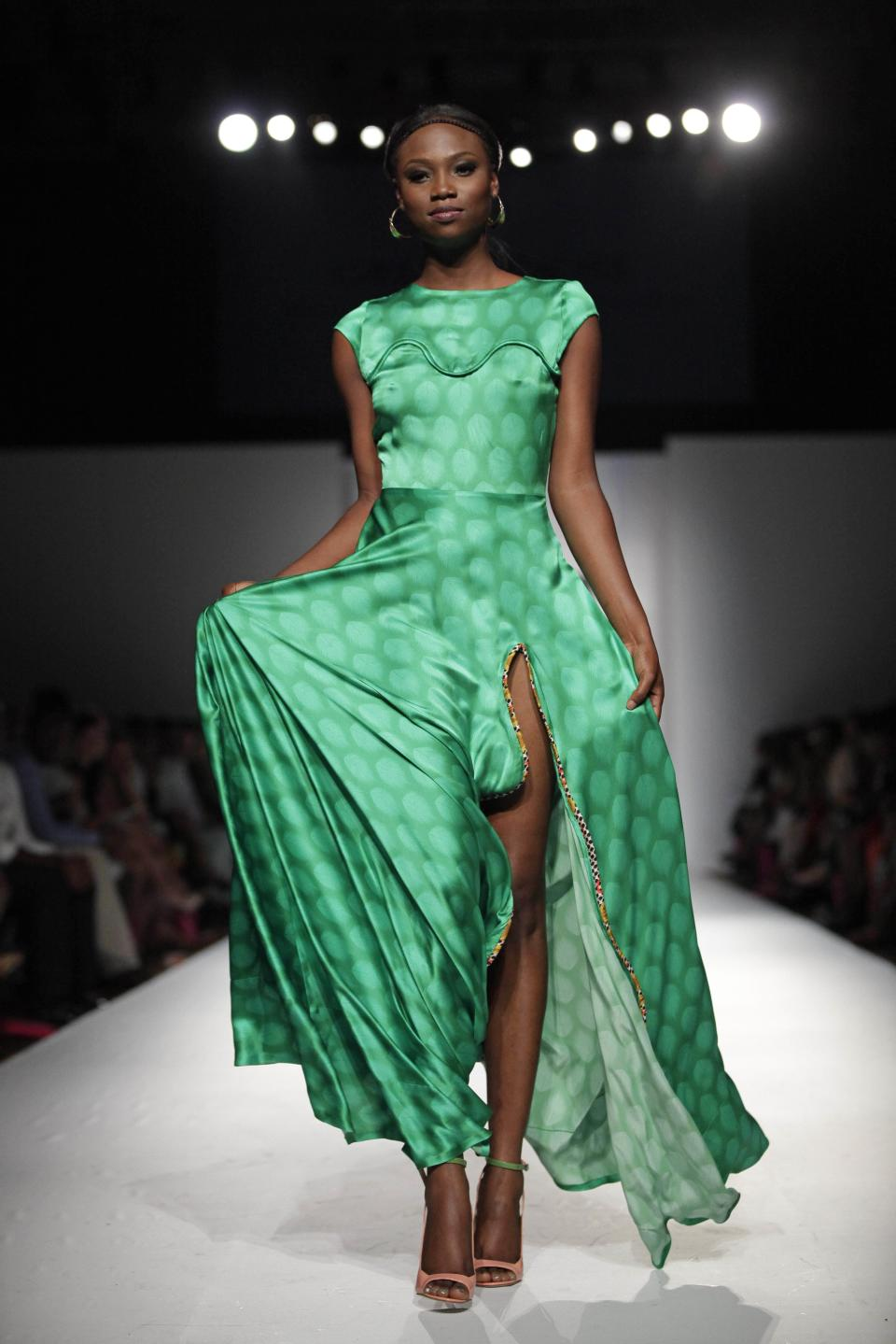 A model displays a creation designed by Jewel by Lisa during the MTN Fashion and Design Week in Lagos, Nigeria, Saturday, Oct. 27, 2012. (AP Photo/Sunday Alamba)
