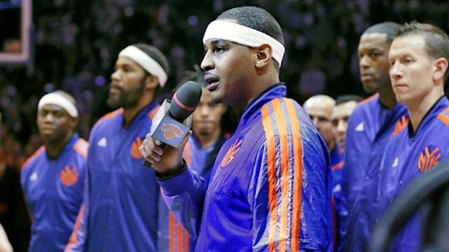 New York Knicks forward Carmelo Anthony addresses the crowd during a moment of observance for the victims of Hurricane Sandy, before they opened their season against the Miami Heat (Reuters)