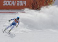 Austria's Matthias Mayer reacts in the finish area during the Men's Alpine Skiing Downhill at the Rosa Khutor Alpine Center during the Sochi Winter Olympics on February 9, 2014