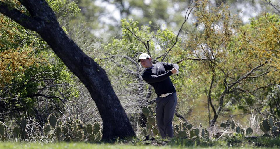 Rory McIlroy, of Northern Ireland, hits from the rough on the eighth hole during the first round of the Texas Open golf tournament, Thursday, April 4, 2013, in San Antonio.  (AP Photo/Eric Gay)